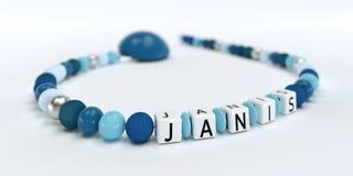 Uma corrente azul da chupeta para meninos com nome Janis Imagens de Stock Royalty Free