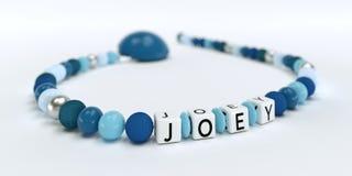 Uma corrente azul da chupeta para meninos com nome Joey Fotografia de Stock Royalty Free
