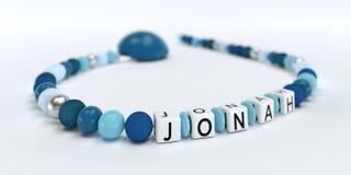 Uma corrente azul da chupeta para meninos com nome Jonah Fotos de Stock Royalty Free