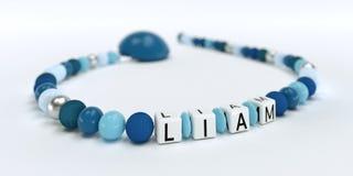 Uma corrente azul da chupeta para meninos com nome Liam Fotografia de Stock Royalty Free