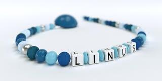 Uma corrente azul da chupeta para meninos com nome Linus Imagens de Stock