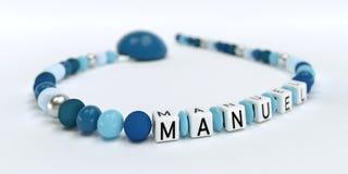 Uma corrente azul da chupeta para meninos com nome Manuel Foto de Stock