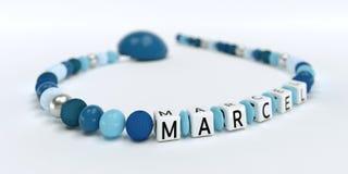 Uma corrente azul da chupeta para meninos com nome Marcel Fotos de Stock Royalty Free