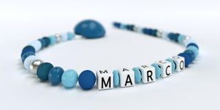 Uma corrente azul da chupeta para meninos com nome Marco Imagens de Stock Royalty Free