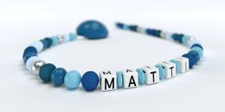 Uma corrente azul da chupeta para meninos com nome Matti Fotografia de Stock Royalty Free
