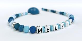 Uma corrente azul da chupeta para meninos com nome Melvin Foto de Stock Royalty Free
