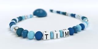 Uma corrente azul da chupeta para meninos com nome Tim Foto de Stock Royalty Free
