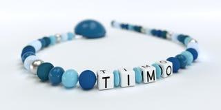 Uma corrente azul da chupeta para meninos com nome Timo Imagens de Stock
