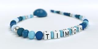 Uma corrente azul da chupeta para meninos com nome Timon Imagens de Stock