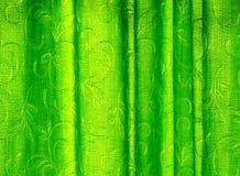 Uma cortina verde retroiluminada Imagens de Stock