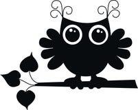 Uma coruja preta Fotografia de Stock