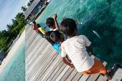 Uma criança aciganada do mar local Fotografia de Stock