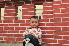 Uma criança chinesa Fotos de Stock Royalty Free