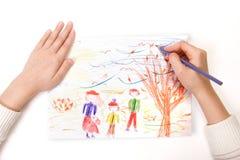 Uma criança desenha Imagem de Stock Royalty Free