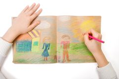 Uma criança desenha Fotografia de Stock