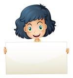 Uma criança feliz que guardara um quadro indicador vazio Foto de Stock Royalty Free