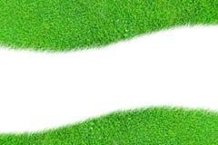 Uma curva do espaço em branco da grama verde isolada Foto de Stock Royalty Free