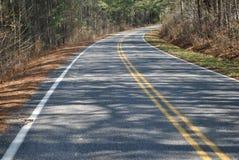 Uma curva em uma estrada Fotografia de Stock