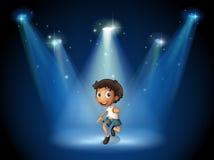 Uma dança do menino com projetores Imagem de Stock Royalty Free