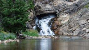 Uma das cachoeiras no lago McDonald Fotografia de Stock