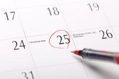 Uma data circundada em um calendário Fotografia de Stock