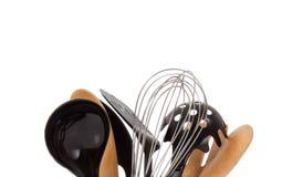 Uma disposição de utensílios da cozinha no branco Fotos de Stock Royalty Free