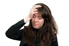 Uma dor de cabeça Fotos de Stock Royalty Free