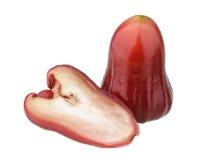 Uma e uma metade de maçãs cor-de-rosa vermelhas Fotos de Stock Royalty Free