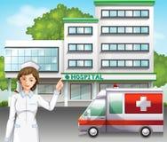 Uma enfermeira na frente do hospital Imagens de Stock