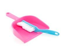 Uma escova azul e uma cor-de-rosa brushpan Imagem de Stock Royalty Free