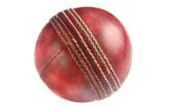 Uma esfera de grilo vermelha usada velha. Foto de Stock