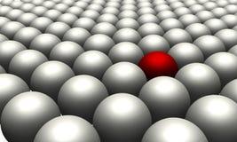 Uma esfera vermelha dentro entre muitas esferas brancas Fotos de Stock