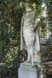 Uma estátua em Quadrado du Pequeno Sablon em Bruxelas fotografia de stock