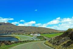 Uma estrada à área rural Foto de Stock Royalty Free