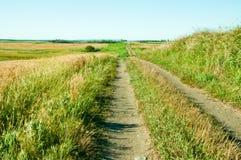 Uma estrada áspera longa adiante Foto de Stock Royalty Free