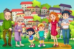 Uma família na cume através da vizinhança Foto de Stock Royalty Free