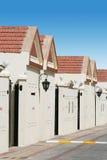 Uma fileira de casas de cidade Imagens de Stock