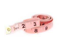 Uma fita de medição da cor-de-rosa Imagens de Stock