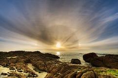 Cena impressionante da praia do cão do sol foto de stock