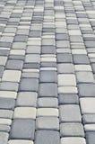 Uma foto detalhada do quadrado, apresentada da pedra de pavimentação moderna com cantos arredondados Projeto exato da área pedest foto de stock