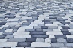 Uma foto detalhada do quadrado, apresentada da pedra de pavimentação moderna com cantos arredondados Projeto exato da área pedest fotos de stock royalty free