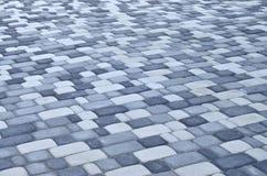 Uma foto detalhada do quadrado, apresentada da pedra de pavimentação moderna com cantos arredondados Projeto exato da área pedest fotografia de stock