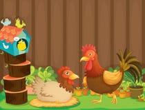 Uma galinha e um galo ao lado da casa do pássaro Imagem de Stock