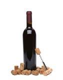 Uma garrafa do vinho, das cortiça e do corkscrew. Fotografia de Stock Royalty Free