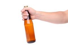 Uma garrafa em uma mão Fotografia de Stock