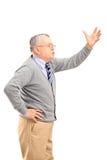 Uma gritaria madura irritada do homem Foto de Stock Royalty Free