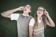 Uma imagem composta dos modernos geeky que olham confundidos Foto de Stock