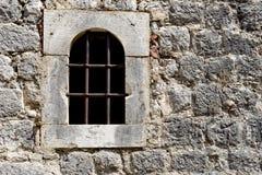 Uma janela com barras imagens de stock royalty free