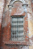 Uma janela com barras fotografia de stock royalty free