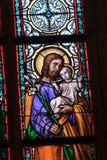 Uma janela do mosaico do vitral da igreja da religião Foto de Stock Royalty Free